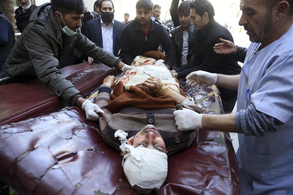 En fotos: Ataques simultáneos a un centro cultural en la capital de Afga...