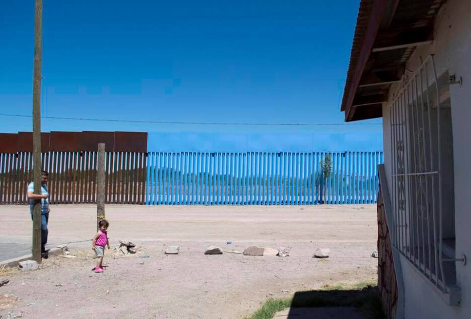 SLIDESHOW: While Trump demands a border wall, an artist makes the fence...