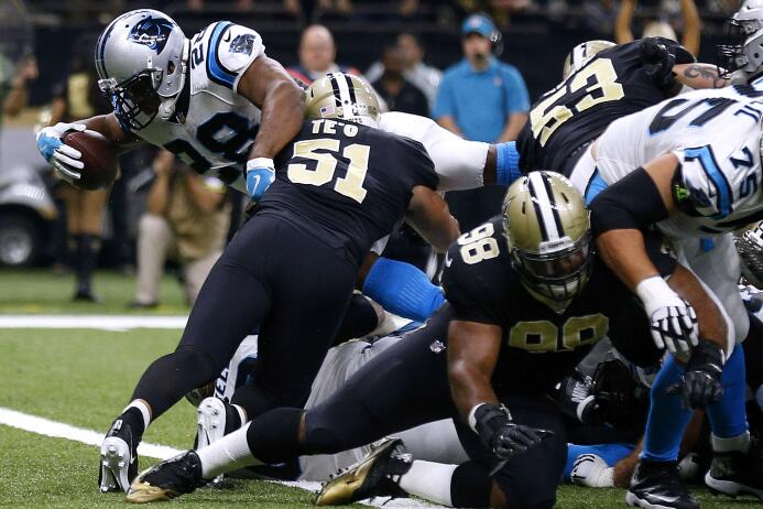 En fotos: Saints vencen a Panthers en duelo de la parte alta del sur en...
