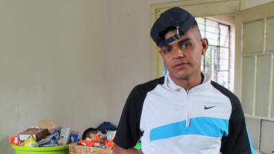 Kevin García, 19, of Comayagua, Honduras, takes a break from sorting don...