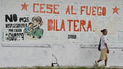 Mural promotor de los diálogos de paz y el cese del fuego en Colo...