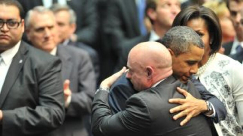 President Obama hugged Mark Kelly, the husband of Representative Gabriel...