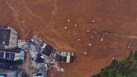 Hombre sobrevivió 60 horas tras deslave en China desastre6.jpg