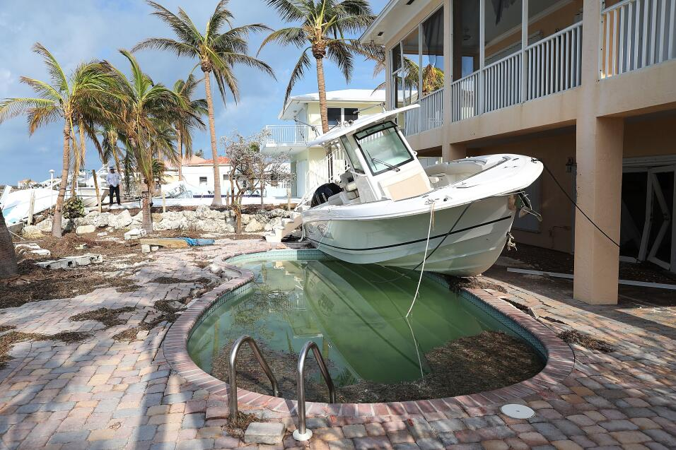 A boat is seen next to a home after Hurricane Irma passed through the ar...