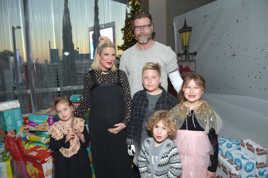 Actress Tori Spelling and actor Dean McDermott and their children (L-R)...