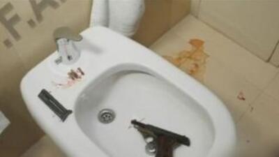 Imagen del video de la policía donde se muestra el arma de Nisman.