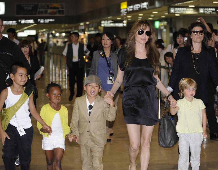 Angelina Jolie (2R), accompanied by her children Maddox (L), Zahara (2L)...