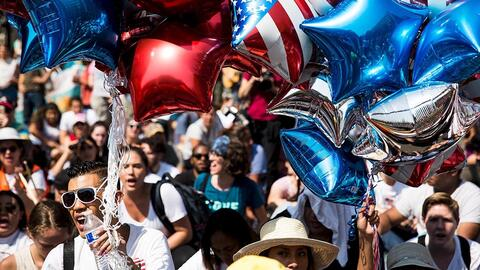 Protesters supporting DACA hold balloons in the colors of the American f...