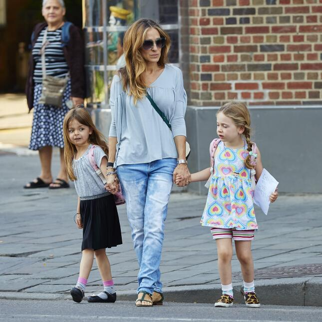 Sarah Jessica Parker is spotted wearing a gray shirt and denim jeans whi...