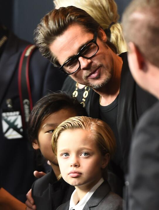 Actor Brad Pitt and children Pax Jolie-Pitt (hidden) and Shiloh Jolie-Pi...