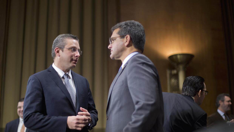 El gobernador García Padilla junto a Pierluisi, comisionado residente.