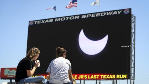 FORT WORTH, TX - AUGUST 21: Spectators watch the solar eclipse as it is...