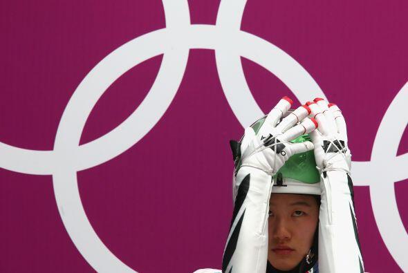 Eunryung Sung, de EEUU, se prepara para su primera carrera en el tercer...