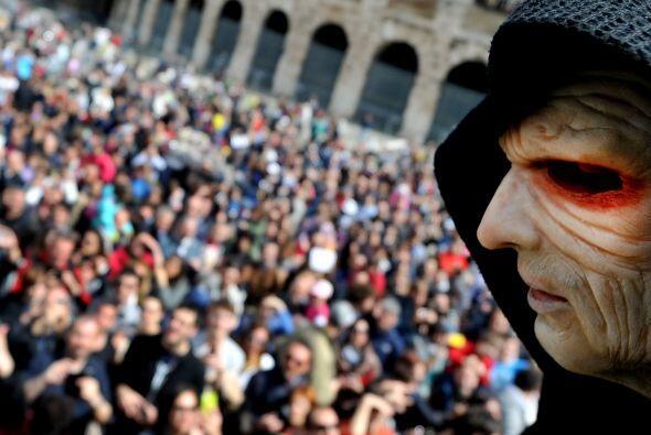La cita en Italia fue en torno al majestuoso Coliseo romano, símbolo de...