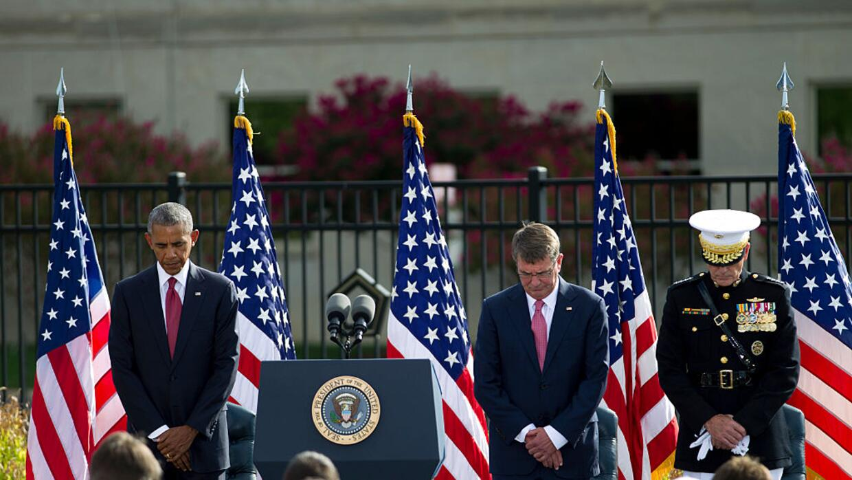 US President Barack Obama accompanied by Defense Secretary Ash Carter an...