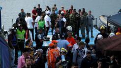 Decenas de personas siguen desaparecidas tras un naufragio de un bote en...