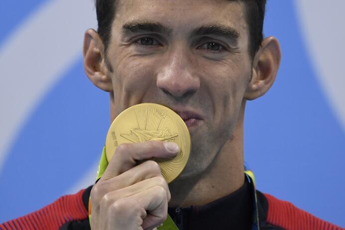 Phelps logra su cuarto título olímpico en esta prueba con una marca de 1...