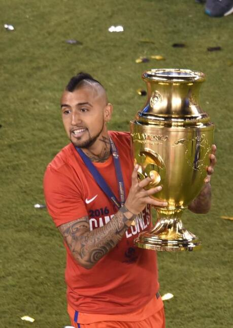 Arturo Vidal also celebrated, despite missing his penalty kick