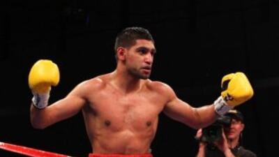 Khan campeón mundial superligero nuevamente.