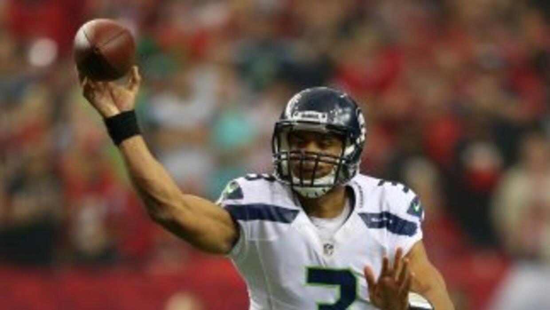 Russell Wilson llevó a los Seahawks a playoffs en su primer año como pro...