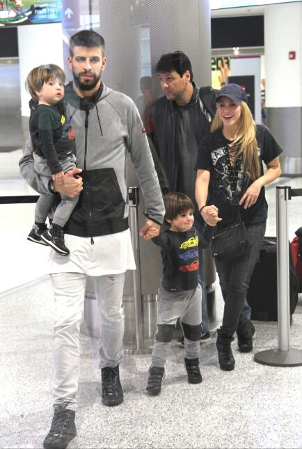 Shakira, Gerard Pique along side their two sons are all smiles as they a...